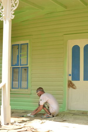 Michael Willetts of Johns Painting prepares to paint one of the structures at the Historic Village.